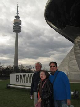standing in front of the BMW Welt. it was a very entertaining place to visit (specially for car lovers like me). photo with my parnets. , Vic - December 2012