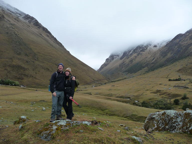 All smiles at the bottom of the pass - Cusco