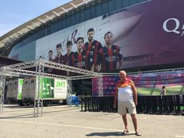 This is me standing in front of the picture of the Barcelona stars pictured on the stadium wall , ROGER H - August 2015