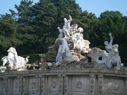 Photo of Vienna Schonbrunn Palace Evening: Palace Tour, Dinner and Concert A grand water fountain at Schonbrunn Palace