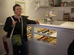 Our guide, Carrie, at the cupcake shop., Laura All Over - May 2013