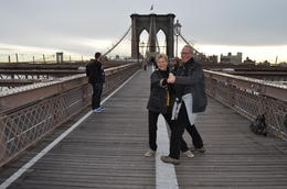 Photo of New York City Private New York Walking Tour with a Personal Photographer Dancing on Brooklyn Bridge
