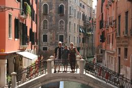 My husband, son and I on one of the many beautiful bridges in Venice. Every picture looks like a movie set! - July 2009