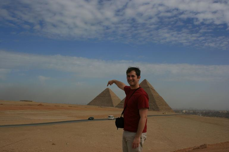 Touching top of pyramid - Cairo