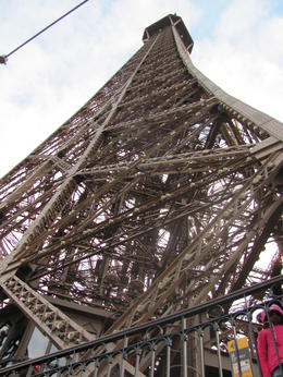 the view up to the top of the Eiffel tower from level 1 , Lidia - July 2012