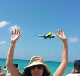 Having fun at Maho Beach a long with hundreds of other people , Nelia S - February 2016