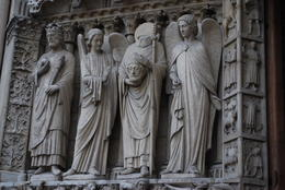 For those that know this saint, he is the one holding his beheaded noggin. When in France, you can find images and statues of him everywhere. This statue resides over one of the doors to Notre Dame. , Jeff & Kathy - July 2012