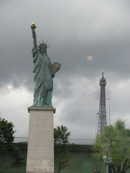 I had no idea there was a statue of Liberty in Paris? Taken from Seine river boat , Lidia - July 2012