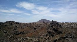 During the short hike to the lava tube entrance, the views of the lava fields and mountains are awesome. , Lindsey B - June 2015