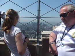 Listening to the audio tour at the top of the ESB , Karen D - June 2011