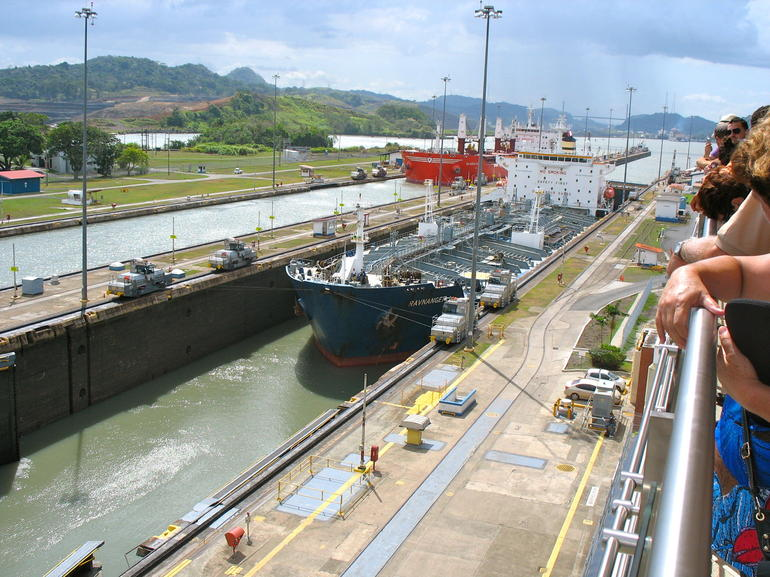View from Miraflora Visitors centre of a ship mgoing thru the lock. - Panama City