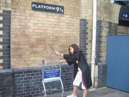 Playing make believe at a location in King Cross station purported to be platform 9 3/4, but we know better now don't we?, Stuart L - July 2008