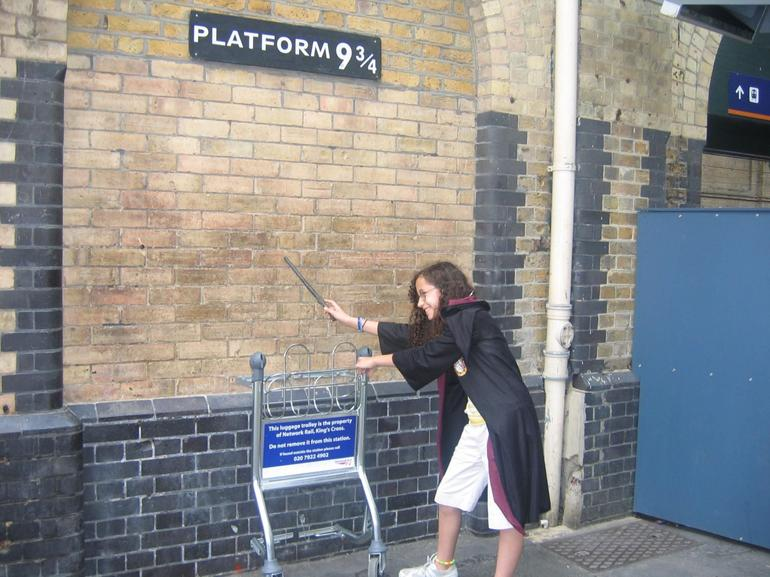 Playing make believe at a location in King Cross station purported to be platform 9 3/4, but we know better now don't we?