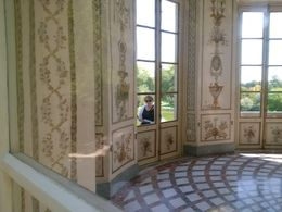 This is a photo I secretly took of my wife as we were marveling at the Belvedere at the Petit Trianon. I think it indicates how Michelle, our tour guide, took pains to show us often missed sights ... , Boris G - September 2015
