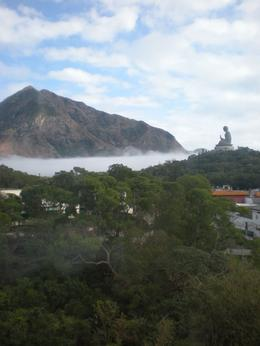 Photo of Hong Kong Lantau Island and Giant Buddha Day Trip from Hong Kong Giant Buddha sitting above the mist