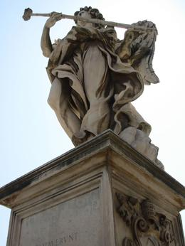 An angel marks the path on the Ponte Sant' Angelo, the bridge to the Castel Sant' Angelo, Rome, Cheryl N - June 2010