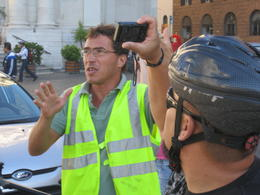 our tour guide explaining our surroundings. i think he was talking about the forum. , artist4rags - October 2012