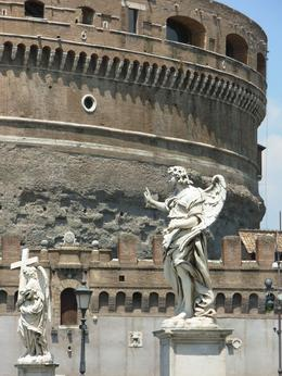 Castel Sant' Angelo, Rome. In the foreground are marble angels carved by Bernini on the Ponte Sant' Angelo, Cheryl N - June 2010