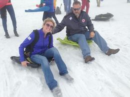 Photo of Zurich Mount Titlis Day Tour from Zurich Sledding on top of Mount Titlis