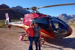My husband and me in front of the helicopter after landing in the canyon. , Douglas H - November 2014
