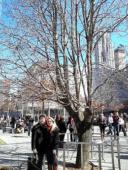 My wife and daughter standing next to the Survivor Tree. , James W F - March 2014