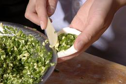 Putting the egg and leek inside the dumpling wrap - May 2012
