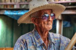 Photo of Bangkok Floating Markets and Bridge on River Kwai Tour from Bangkok Cool boatman