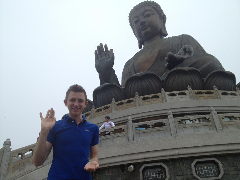 Brock posed with the Big Buddha