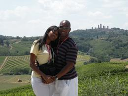 Tuscany in one day tour: We were on the farm after a good meal. We took a picture with San Gimignano in the background. - July 2010