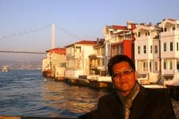 This is my traveling companion and the background is the Asian side of Istanbul, Raymond G - December 2009