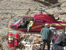 This is a picture of another group of people getting off the helicopter that takes you down inside the Grand Canyon. , Glenn R - March 2014