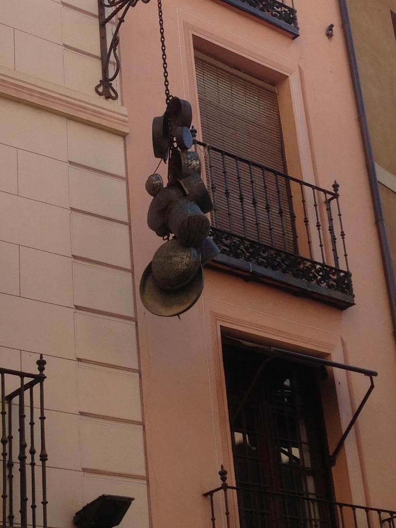Quaint, cobbled streets ... and pots and pans hanging outside the building? - Madrid