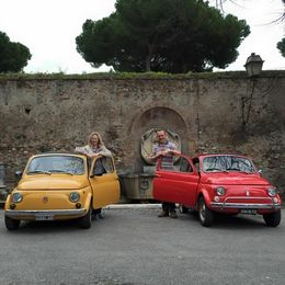 My husband and I outside one of the stops with Geogo, we had the red car. What great fun we had! , Mrs A J J - March 2015