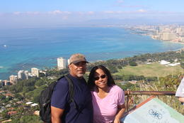 Bruce and Julie (my husband and I) at the top of Diamond Head. Awesome viw of Honolulu in the background. , Bruce F - December 2014
