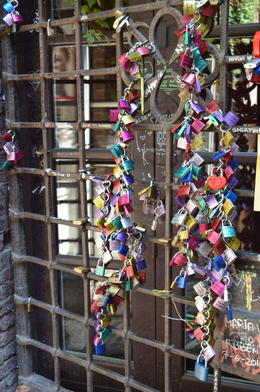 Photo of Verona Verona City Hop-on Hop-off Tour Locks in Juliet's courtyard