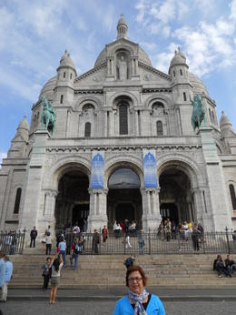 Great part of the tour: viewing Paris from the steps of the church of Montmartre. , Paul T - July 2011