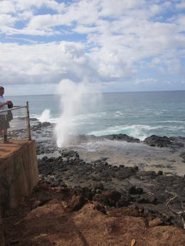 One of the first actual tour stops is this place where you can see water spout through wholes in the lava...pretty awesome! , Thurman - August 2012