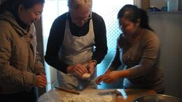 Photo of Xian Experience Xi'an: Dumpling Making and Family Cooking Class Rolling dumplings