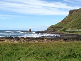 Taken from the walking tour; you can see all the elements of the Giant's Causeway: hiking trails, crashing waves, flowers, grassland, rock formations, the red earth, the towers of rock, all in vivid ... , Vicki M - August 2013