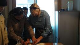 Being taught how to properly roll dumplings - January 2013
