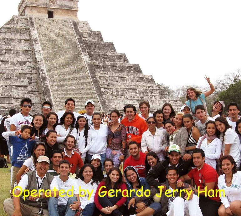 Gerardo and his group posing in front - Cancun