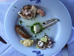 For our primo piatto at lunch, we were served a variety of delicious seafood. From top clockwise: seafood salad w/ shrimp/cuttlefish/octopus/mussel anchovies marinated in lemon octopus/potato salad ... , Whitney H - June 2015