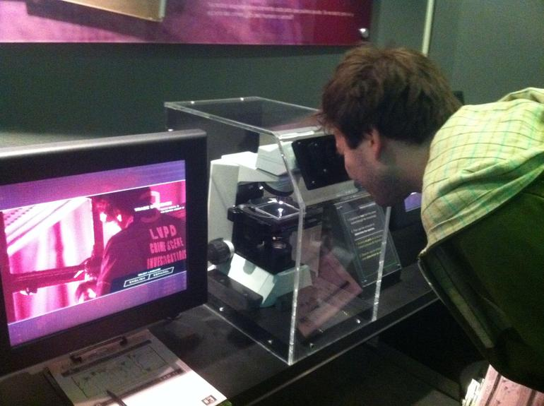 Daniel checking out fibers through the microscope