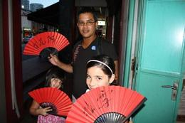Photo of Singapore Singapore's Chinatown Trishaw Night Tour Red Fan - our name in Chinese