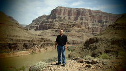 Photo of Las Vegas Grand Canyon Helicopter Tour from Las Vegas Standing in front of the Colorado River