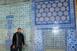 Behind me are the wall art paintings inside the Topkapi Palace, Raymond G - December 2009