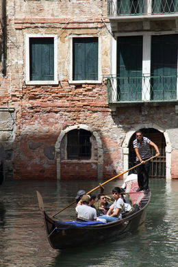 As you walk through Venice at nearly every turn there is a small canal where you would normally find a road in any other town or city. Where there is a canal there is a tourist in a gondola. , Jenny H - August 2015