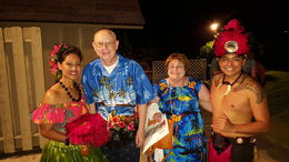 My husband and I and the performers at the luau , Ronnie O - April 2016