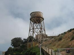 The old and rusted water tower. Some of the buildings are slowly being restored on the Island., Mark M - July 2009