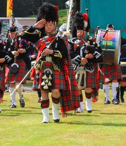 One of the pipe bands entering the stadium where the games were held at Braemar , Julie G - September 2013